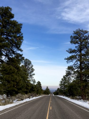 Homeschoolers homeschooling family travel adventure things to do with kids teens flagstaff arizona az ancient volcanoes sunset crater volcano national monument national parks nps junior ranger rangers badge badges program hiking trails american southwest snow winter fun spgfan smiles per gallon