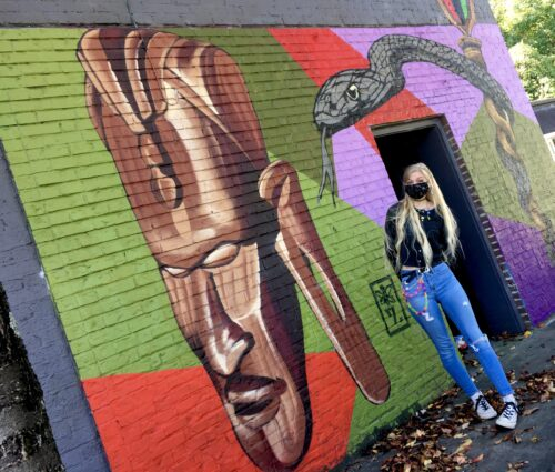 Homeschoolers homeschooling family travel adventure things to do with kids teens chattanooga tn brainerd tennessee urban canvas street art murals spraypaint grafitti african woodcarving snake staff by the artist seven spgfan smiles per gallon